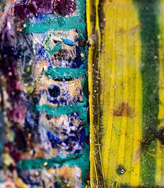 Diptych, resin on pop corn container next to multi colour field.